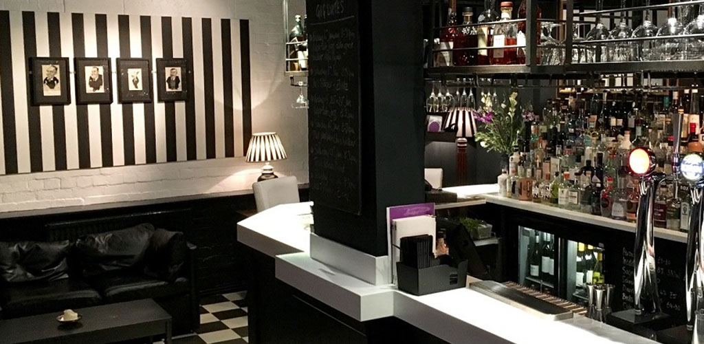 The classy black and white bar at Trippets Bar