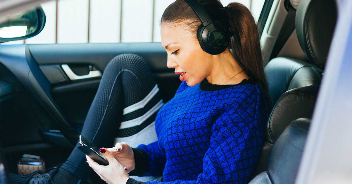 Woman reading her texts in a car