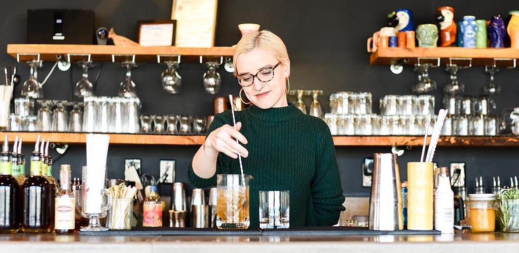 The beautiful bartender mixing drinks at Cardinal Spirits