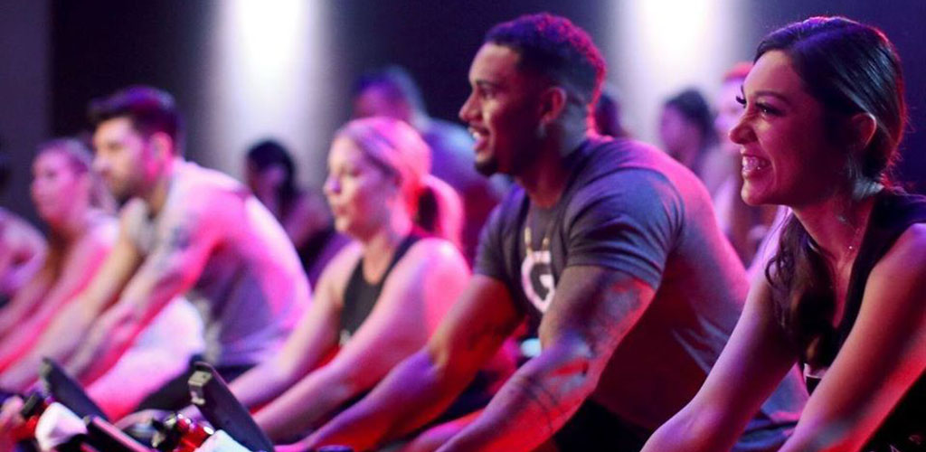 A neon-lit spin class at CycleBar