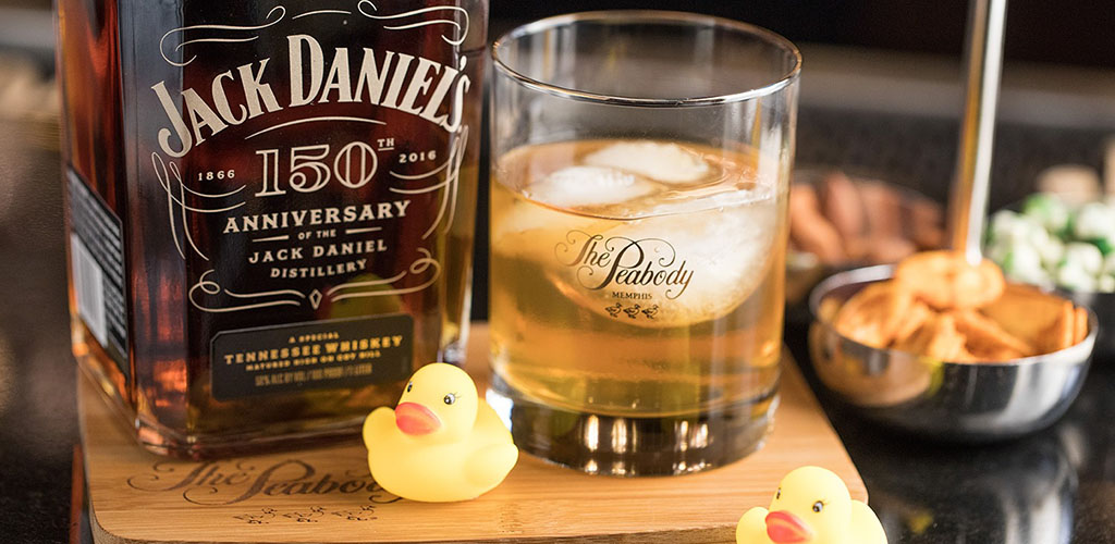 A glass of whiskey with cute rubber duckies at the Lobby Bar at Peabody's