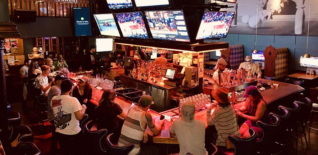 The bar at Q's Billiard Club during a basketball game