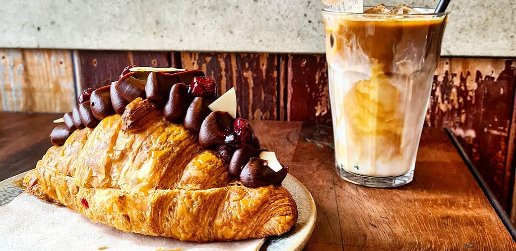 A croissant and iced coffee from Tamper Coffee