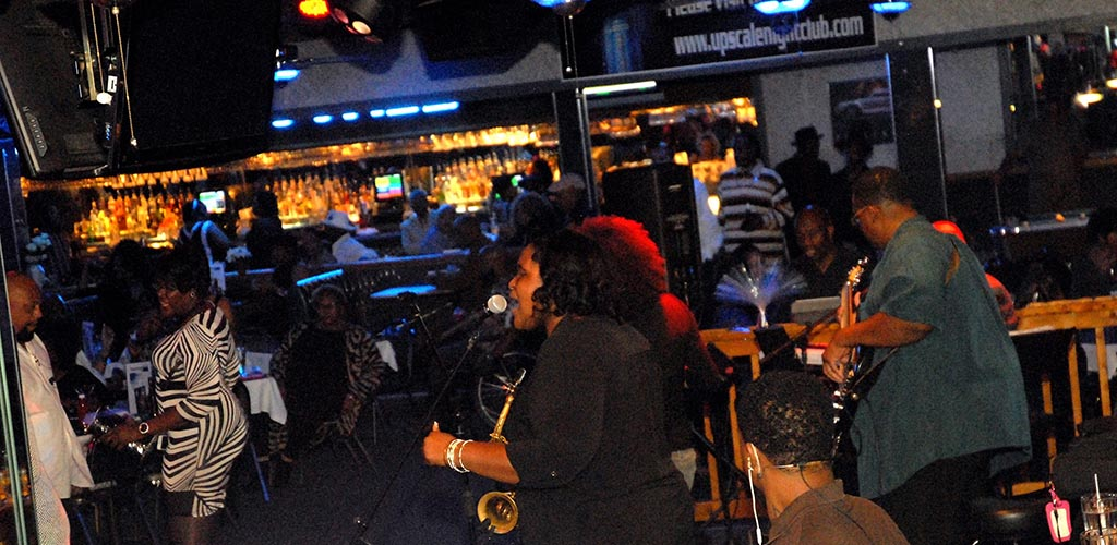 A live performance at Upscale Nightclub and Lounge with cougars in Virginia on the dancefloor