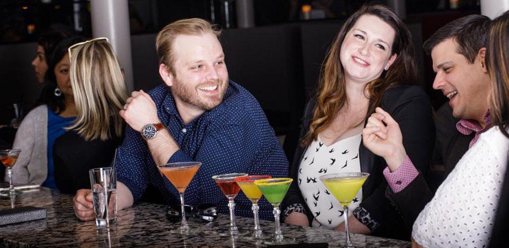Men and women enjoying cocktails from Venetian Moon