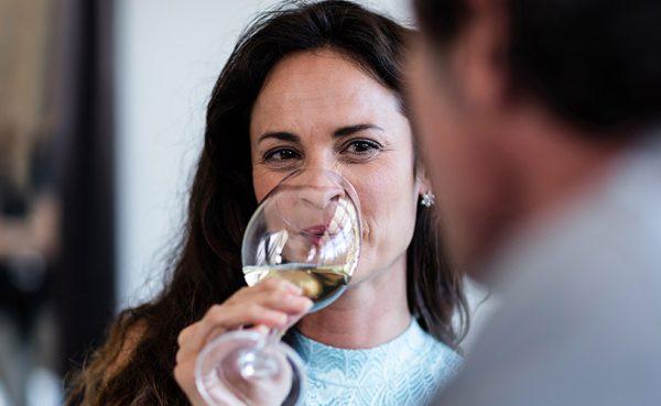 A beautiful woman drinking wine