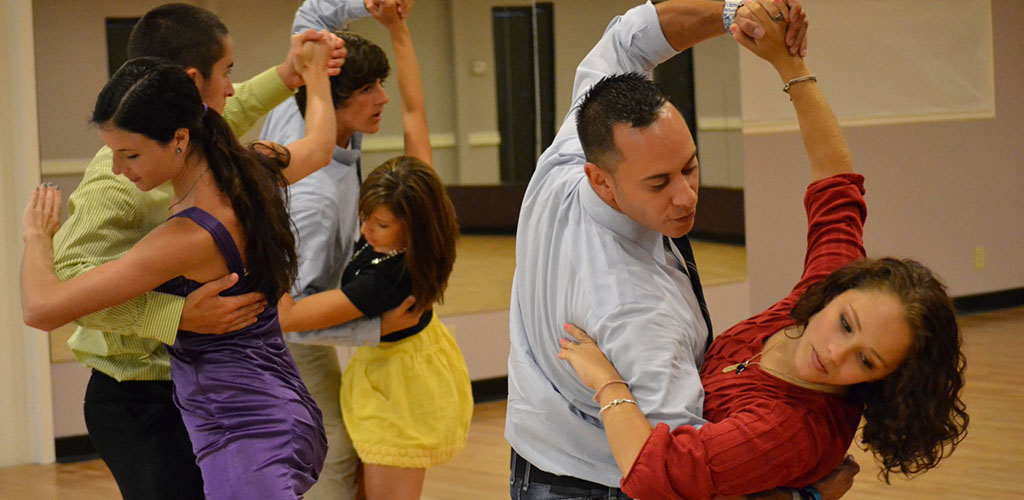Partners at a dance class in Carolina Dancesport