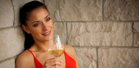 An attractive cougar in Mississippi drinking wine