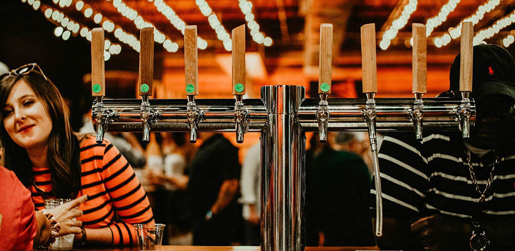 A woman near the taps at Great Raft Brewing
