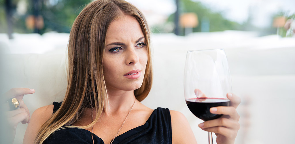 A fierce New Jersey MILF with a glass of wine