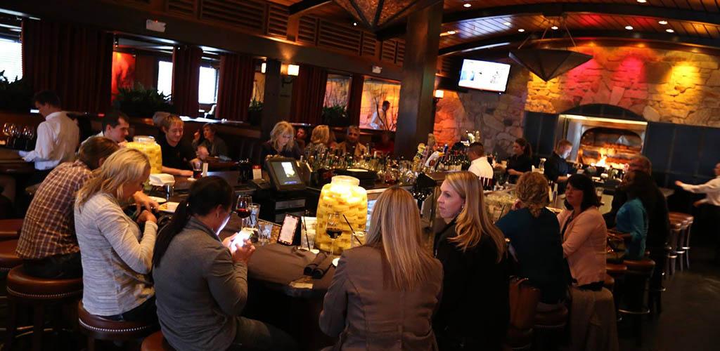 Ladies enjoying drinks at Redstone American Grill