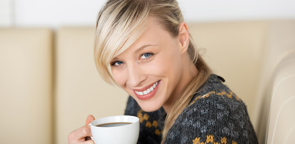 A smiling Massachusetts MILF with a cup of coffee