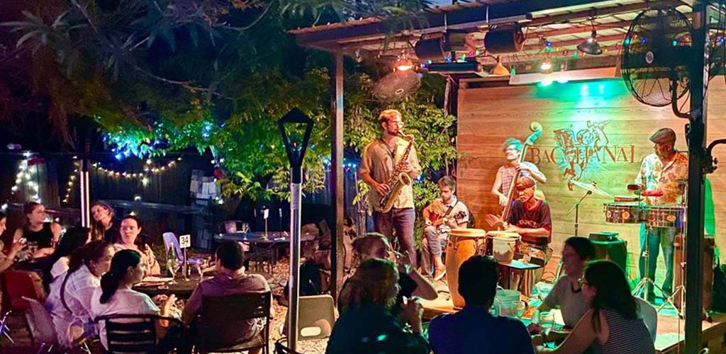 An outdoor acoustic performance at Bacchanal