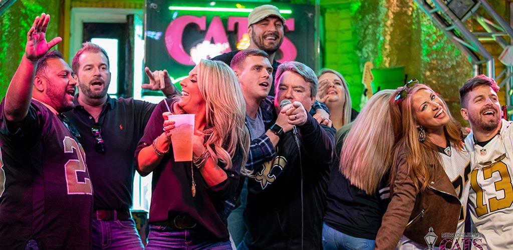 Singing karaoke at Cat's Meow