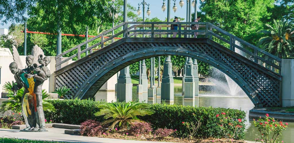 The scenic bridge and garden at Louis Armstrong Park
