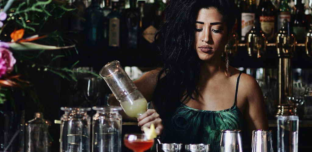A beautiful mature woman mixing drinks at The Diamond