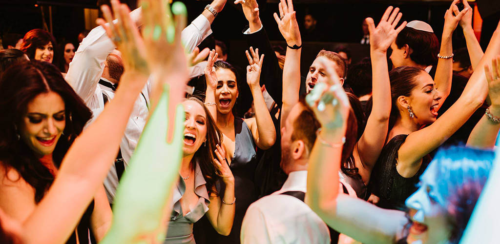 Partygoers with their hands up in the air at 4Sixty6