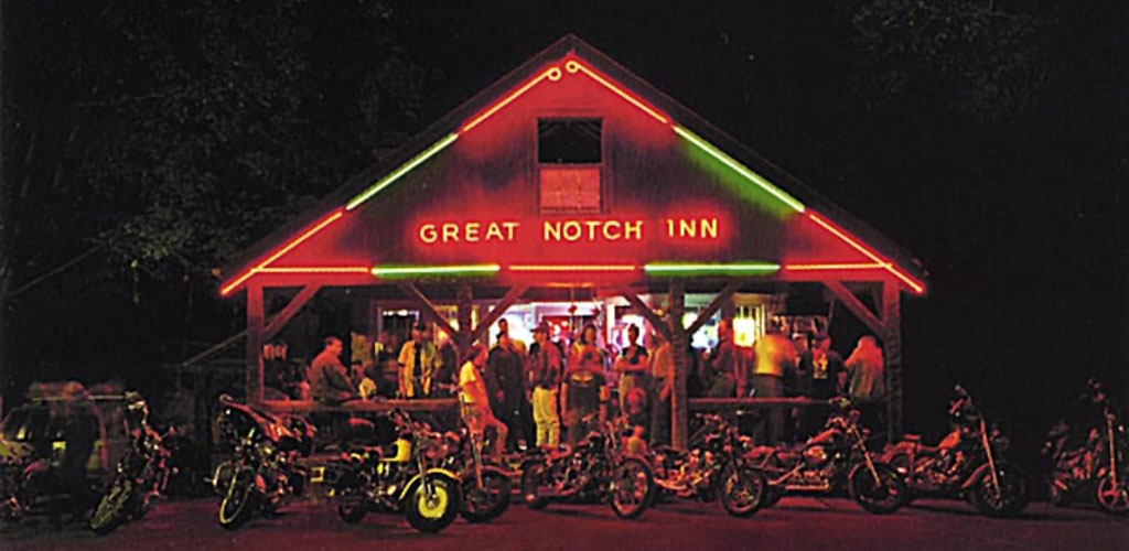 The bright neon lights at the Great Notch Inn at night