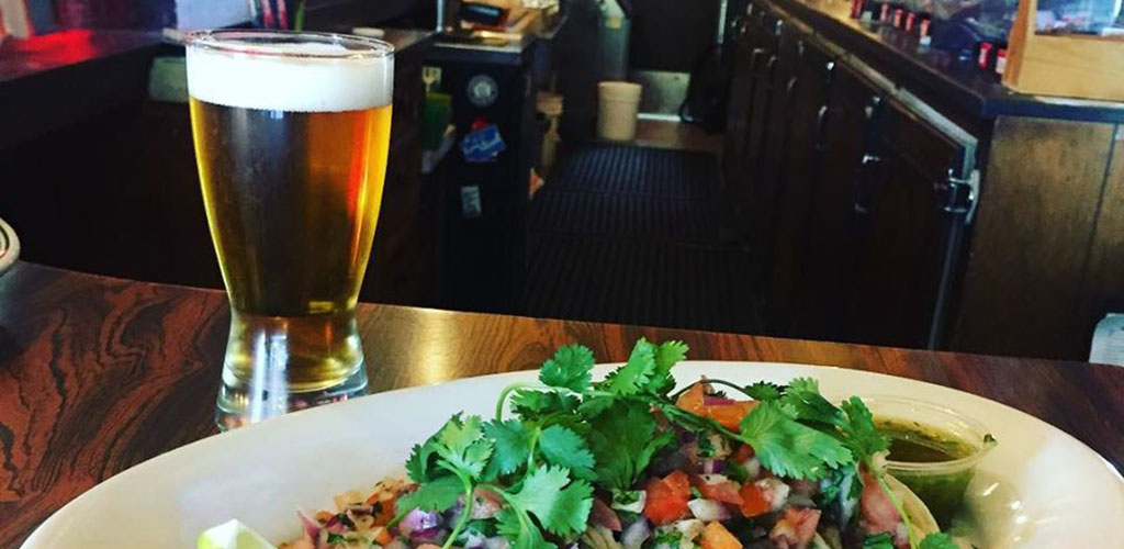 A beer and appetizer from The Sloop Tavern