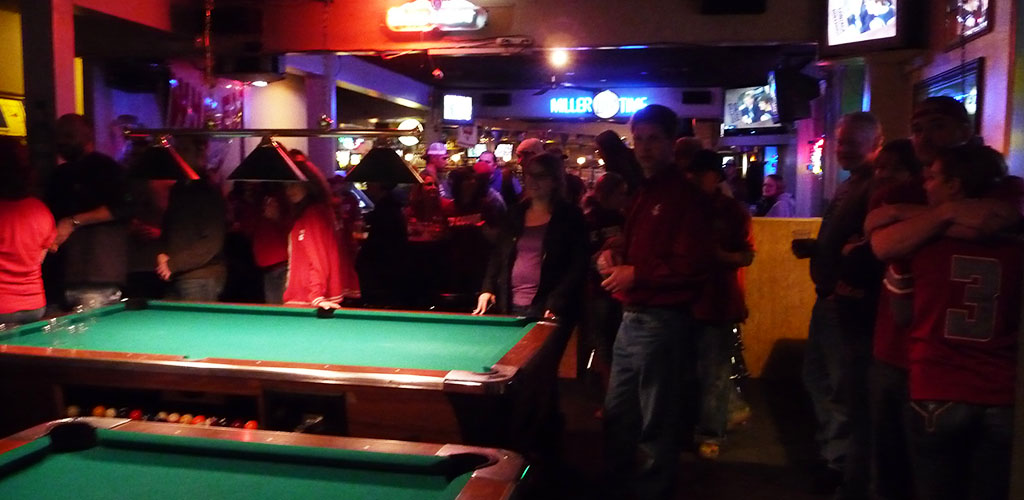 People playing pool at Marco Polo Bar and Grill