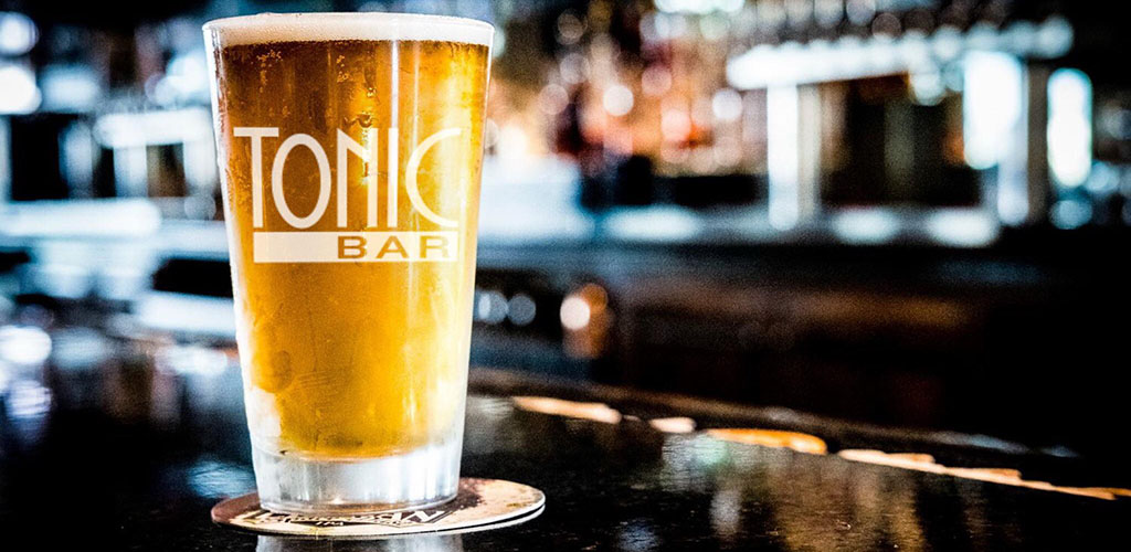 A tall glass of beer at Tonic Bar