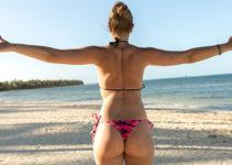 Stretching Brazilian MILF on the beach