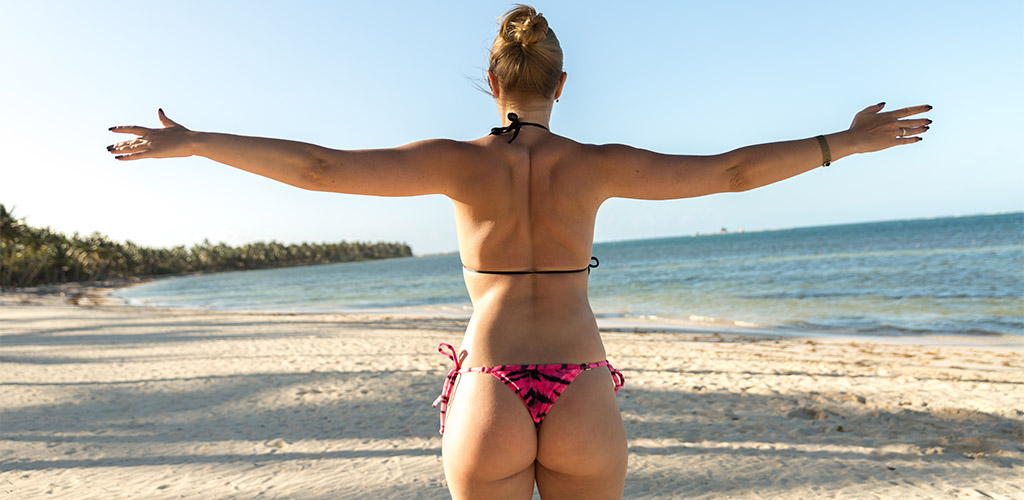 Stretching Brazilian MILF on the beach