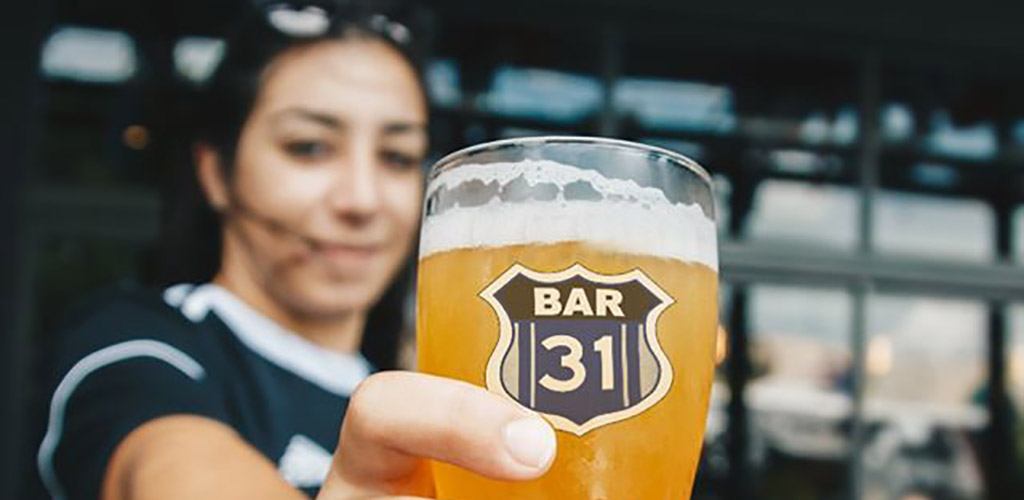 A beautiful woman holding a beer from Bar 31