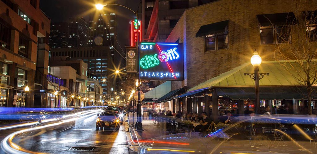 The outdoor patio area of Gibsons Bar & Steakhouse at night