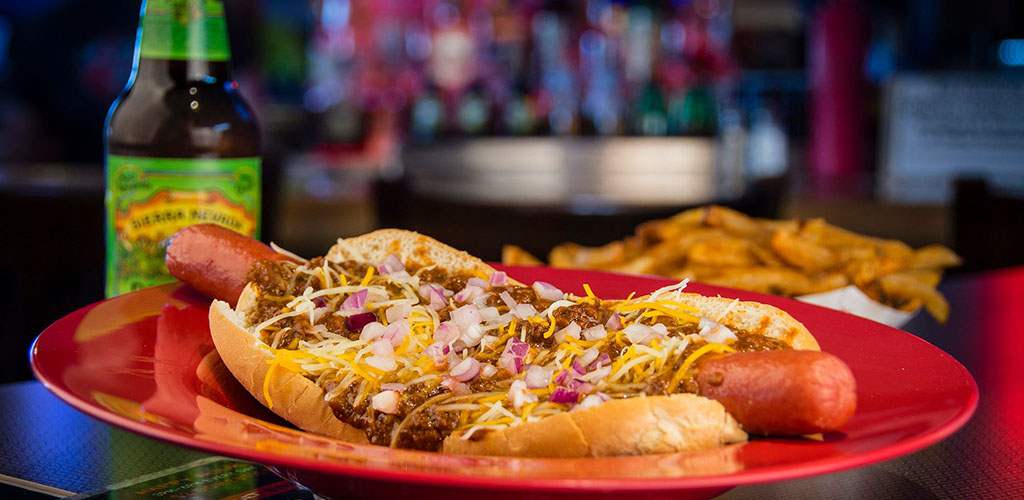 A hotdog with lots of toppings from Smitty's Garage Burgers and Beers