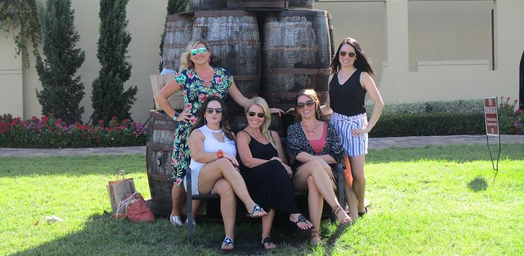 Beautiful mature woman posing in front a large wine barrel at Lakeridge Winery