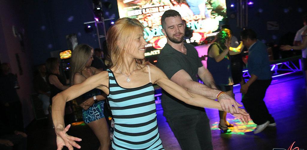 A beautiful woman on the dance floor of Salsa Atlanta
