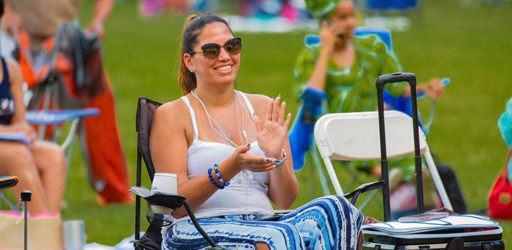 A woman enjoying the show at the Atlanta Jazz Festival