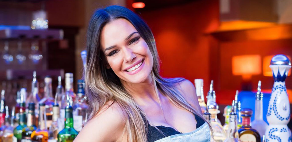 A gorgeous woman posing at the bar in Blue Martini