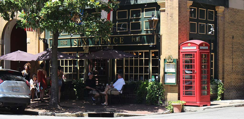 The Six Pence Pub patio on a sunny afternoon
