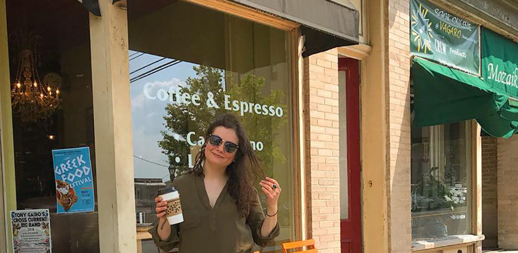 A beautiful woman enjoying her coffee from The Wise Bean