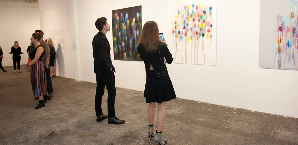 A woman admiring some artwork at Dallas Contemporary