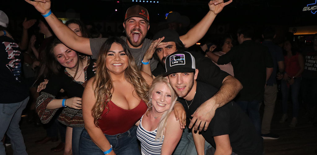 A group of friends partying at Electric Cowboy
