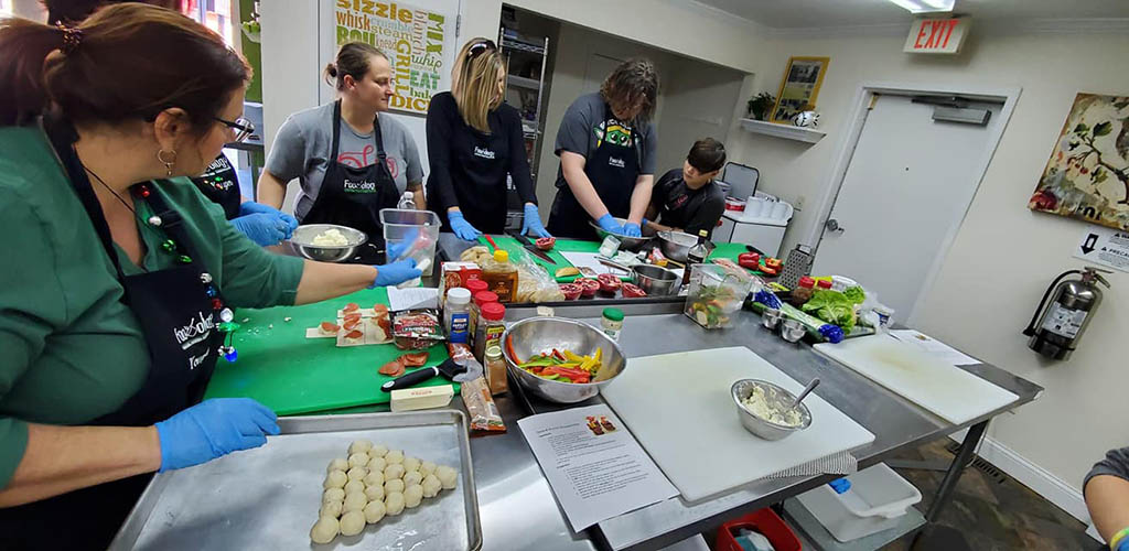 Women in a cooking class at Foodology