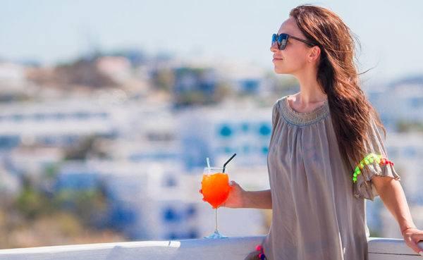 Greek MILF with orange drink