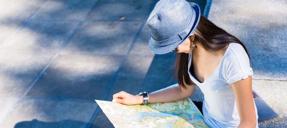 Japanese cougar looking at a map