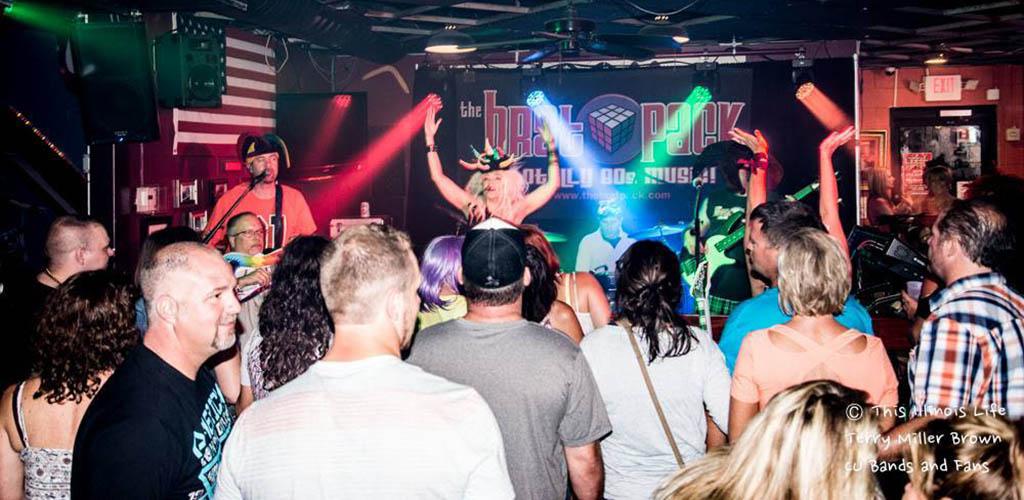 A live performance drawing in a crowd at Boomerangs Bar and Grill