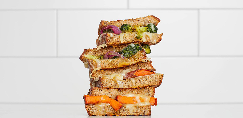 A stack of sandwiches made with ingredients from Whole Foods