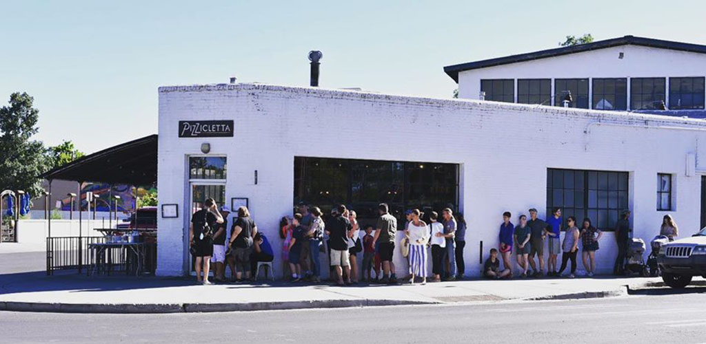 People lined up at Pizzicletta from pizzas