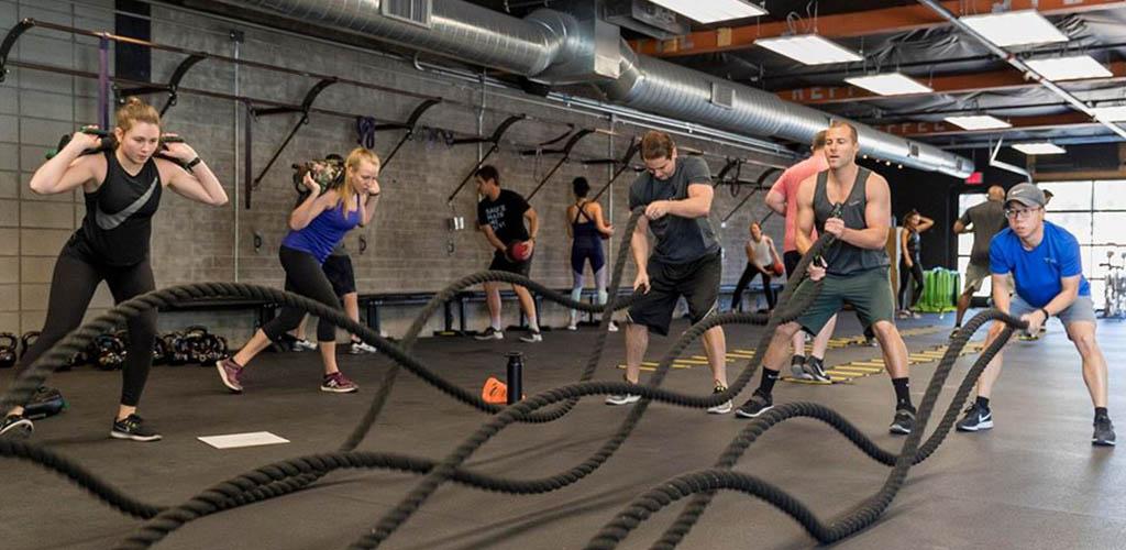 Men and women in intense workouts at BODI