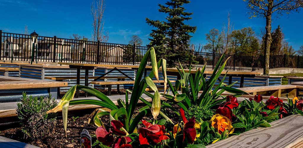 Flowers and benches at Mishawaka Riverwalk