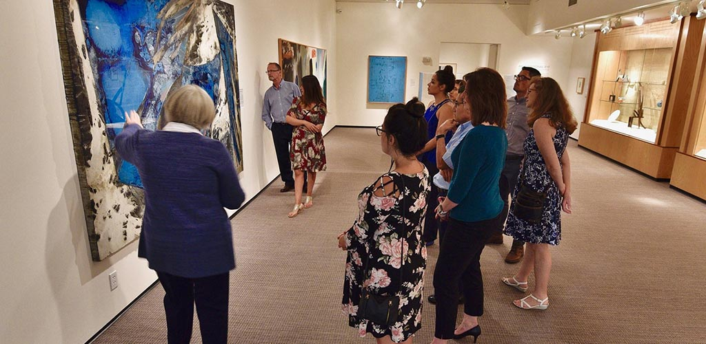A group of women admiring the artwork at the Boise Art Museum