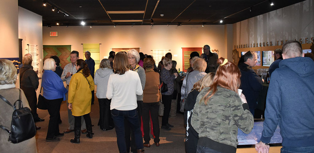 People in the museum at Fontenelle Forest
