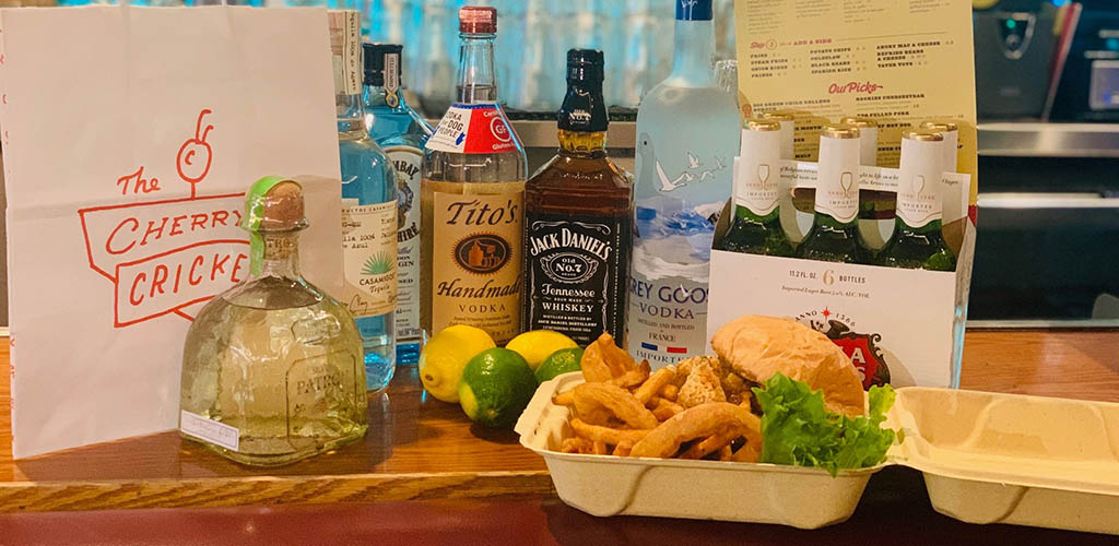 Drinks and a takeout burger box from Cherry Cricket