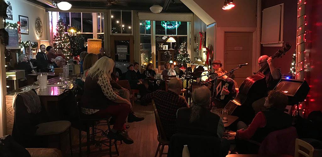 Women enjoying the music at Lakeside Street Coffee House